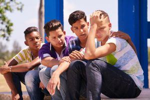 photodune-16753733-group-of-teenagers-boys-supporting-comforting-friend-xxl-min